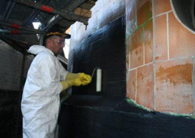 applying carbon fiber wrap to tile tank